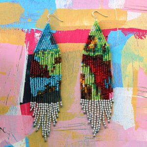 An Image Of 2 Beaded Earrings. There Are Long And Consist Of Blue, Green, Red And White Colours. The Background Is Different Painted Colours Of Pink, Yellow, Blue And White.