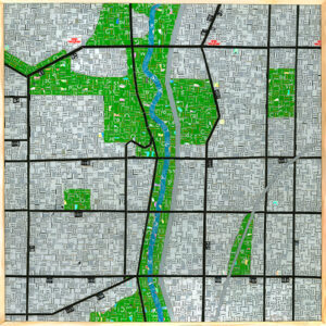 An Image Of A Mosaic Art Piece Made From Metropass Cards. The Mosaic Pieces Form Together To Create A Map Of The Don Valley. Multiple Black Lines Run Through To Represent TTC Lines, While There Is A Green And Blue Part That Runs Down The Middle Of The Image To Represent The Don Valley.