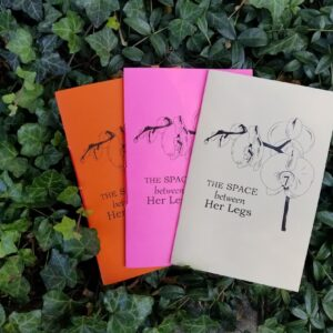 A Photograph Of 3 Books Spread On Top Of Ivy. The Title Of The Book Is,