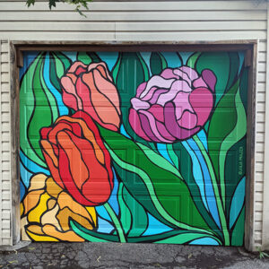 A Photo Of A Mural On A Garage Door. There Are Colourful Tulips With Vibrant Green Steps On A Blue Background. The Flowers Have Crisp Black Outlines.
