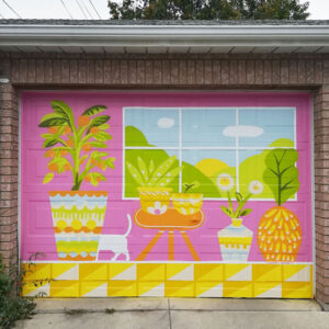 Photograph Of A Garage Mural With A Pink Background, Showing The Tail Of A Cat Passing Behind A Large Planter.