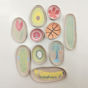 Photograph Of An Assortment Of Greenwares, Showing A Collection Of Colourful Illustration.