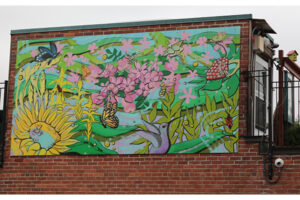 A picture of a mural featuring brightly coloured flowers and butterflies.